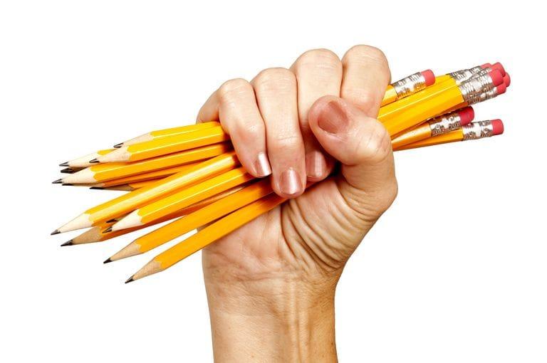 fist grabbing pencils